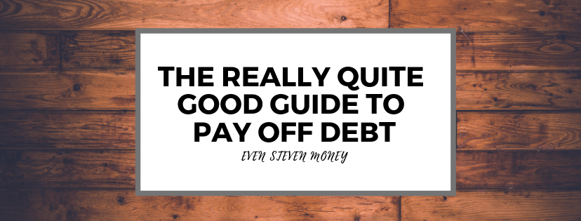 Wood sign with The Really Quite Good Guide to Pay Off Debt printed