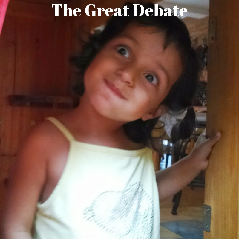 little girl with puffed cheeks text the great debate