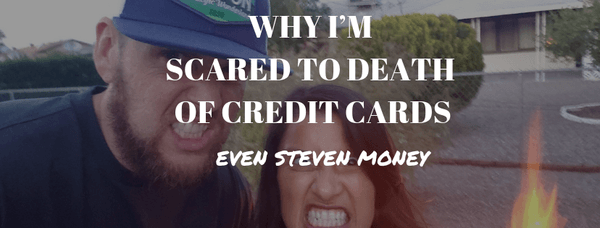 Scared to death of credit cards with couple making scary faces and fire in background