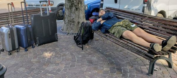 Plan Ahead When Traveling Luggage Sleeping on Park Bench
