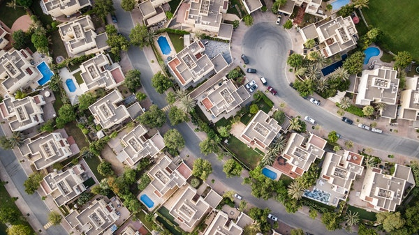 Investment Strategies and Benefits REIT aerial view of houses