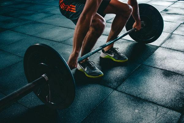 Hire a financial coach person holding barbell