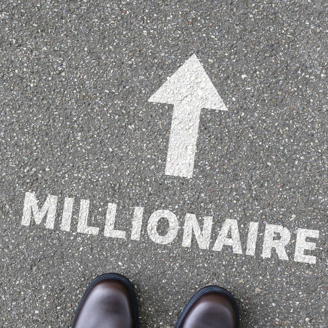 Millionaire with arrow pointing ahead